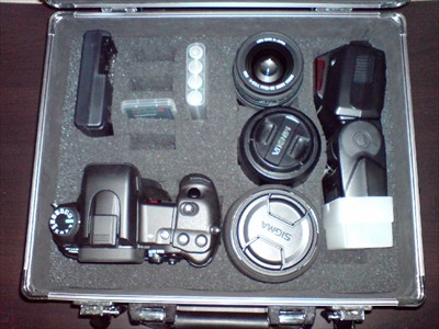 Case with Sony a700, flash and three lenses.