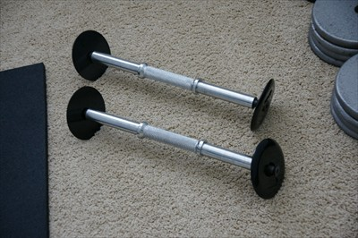 Fixed Dumbell Handles with smooth rounded endcaps Holds up to 150 lbs