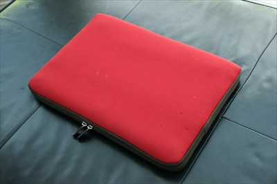 red and brown laptop case sleeve with zipper